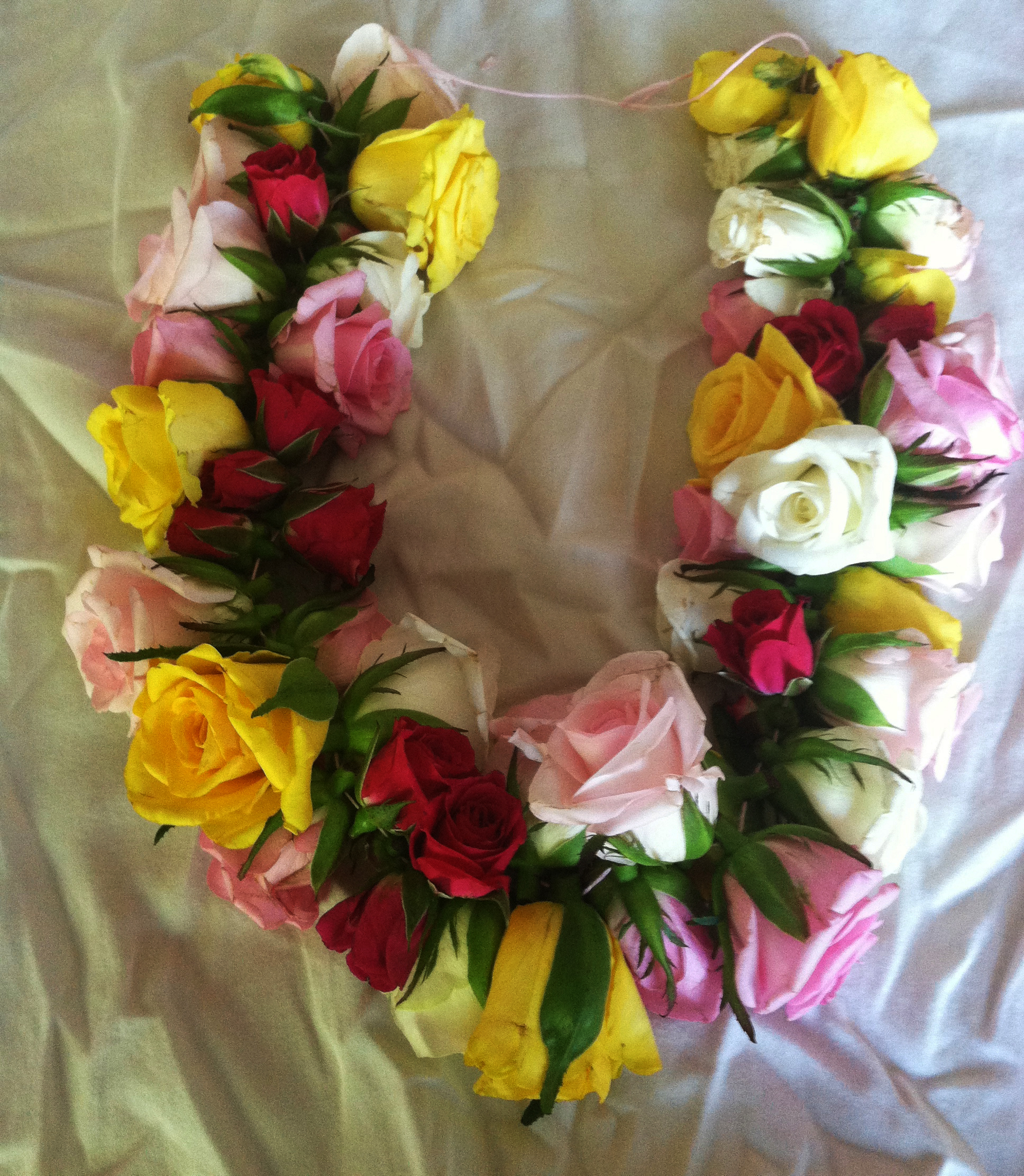 How to make a lei a fresh flower lei with roses go hippie chic rose lei garland izmirmasajfo Gallery