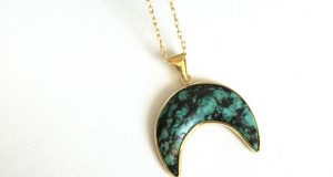 A Moon Necklace In Turquoise And Gold