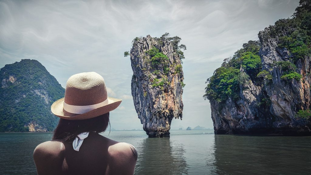 Girl in Thailand wearing a sun hat